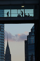 People are seen on a building during the fist day of Spring in New York City. March 20, 2014. Photo by Eduardo Munoz/VIEW