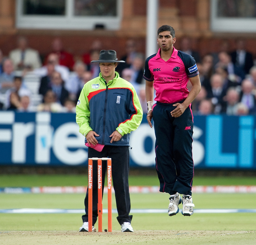 Middlesex Panthers' Ravi Patel leaps in front of umpire Richard Kettleborough<br /> <br />  (Photo by Ashley Western/CameraSport) <br /> County Cricket - Friends Life t20 2013 - Middlesex v Essex - Thursday 04th July 2013 - Lord's, London <br /> <br />  &copy; CameraSport - 43 Linden Ave. Countesthorpe. Leicester. England. LE8 5PG - Tel: +44 (0) 116 277 4147 - admin@camerasport.com - www.camerasport.com