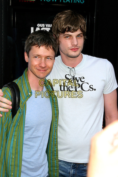 "JOHN CAMERON MITCHELL.""Last Days""  Premiere at the Sunshine Theater in New York City..July 19th, 2005.half length glasses t-shirt t shirt ""save the PCs."" logo slogan.www.capitalpictures.com.sales@capitalpictures.com.©Capital Pictures"