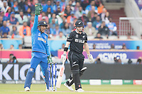 Henry Nicholls (New Zealand) hit in front as MS Dhoni (India) leads an appeal during India vs New Zealand, ICC World Cup Semi-Final Cricket at Old Trafford on 9th July 2019