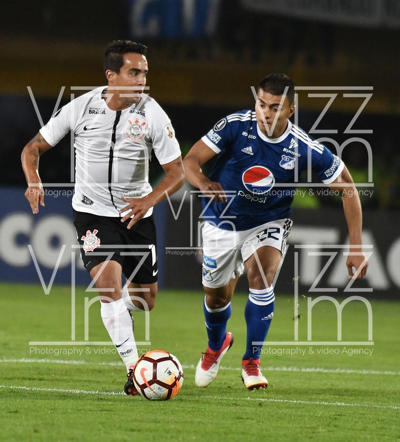 BOGOTA - COLOMBIA – 28 - 02 - 2018: Jhon Duque (Der.) jugador de Millonarios (COL), disputa el balon con Jadson (Izq.) jugador de Corinthians (BRA), durante partido entre Millonarios (COL) y Corinthians (BRA), de la fase de grupos, grupo 7, fecha 1 de la Copa Conmebol Libertadores 2018, en el estadio Nemesio Camacho El Campin, de la ciudad de Bogota. / Jhon Duque (R) player of Millonarios (COL), figths for the ball with Jadson (L) player of Corinthians (BRA), during a match between Millonarios (COL) and Corinthians (BRA), of the group stage, group 7, 1st date for the Conmebol Copa Libertadores 2018 in the Nemesio Camacho El Campin stadium in Bogota city. VizzorImage / Luis Ramirez / Staff.