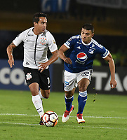 BOGOTA - COLOMBIA – 28 - 02 - 2018: Jhon Duque (Der.) jugador de Millonarios (COL), disputa el balon con Jadson (Izq.) jugador de Corinthians (BRA), durante partido entre Millonarios (COL) y Corinthians (BRA), de la fase de grupos, grupo 7, fecha 1 de la Copa Conmebol Libertadores 2018, en el estadio Nemesio Camacho El Campin, de la ciudad de Bogota. / Jhon Duque (R) player of Millonarios (COL), figths for the ball with Jadson (L) player of Corinthians (BRA), during a match between Millonarios (COL) and Corinthians (BRA), of the group stage, group 7, 1st date for the Conmebol Copa Libertadores 2018 in the Nemesio Camacho El Campin stadium in Bogota city. VizzorImage / Luis Ramirez / Staff.