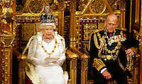 18 May 2016 - London England - Queen Elizabeth II reads the Queen's Speech as Prince Philip Duke of Edinburgh listens during the State Opening of Parliament in the House of Lords in London. The State Opening of Parliament marks the formal start of the parliamentary year and the Queen's Speech sets out the government's agenda for the coming session. Photo Credit: ALPR/AdMedia
