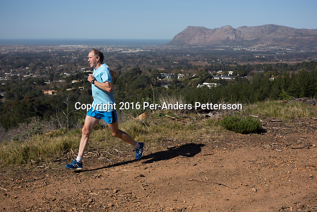 CAPE TOWN, SOUTH AFRICA - AUGUST 10: Tim Noakes,  a South African scientist runs at one of his favorite trails, overlooking Muizenberg on August 10, 2016 in Constantia, outside Cape Town, South Africa.  (Photo by Per-Anders Pettersson/Getty Images)