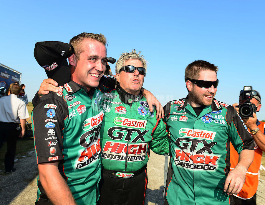 Sept. 22, 2012; Ennis, TX, USA: NHRA funny car driver John Force celebrates with crew members after winning the Traxxas Funny Car Shootout during qualifying for the Fall Nationals at the Texas Motorplex. Mandatory Credit: Mark J. Rebilas-