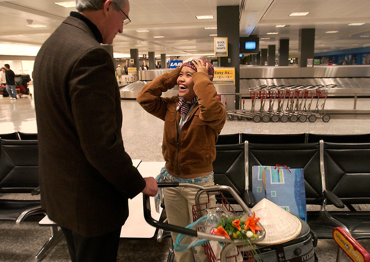 Thuy Anh meets Chuck Atkins at Dulles Airport after she arrived from Vietnam.  Chuck went looking for her because it was believed she was lost.