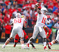Ohio State Buckeyes quarterback J.T. Barrett (16) looks for an open receiver in second half action at Byrd Stadium on October 4, 2014.  (Chris Russell/Dispatch Photo)