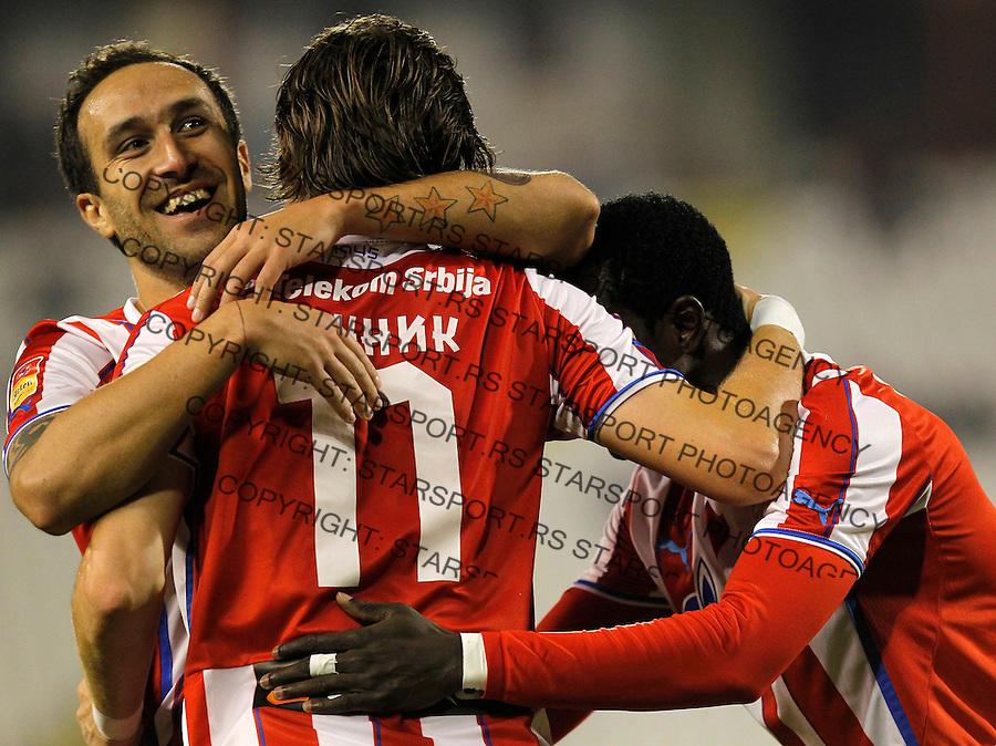 Fudbal Super liga season 2013-2014<br /> Crvena Zvezda v Novi Pazar<br /> Dragan Mrdja (L) Nejc Pecnik and Abiola Dauda (R) celebrates<br /> Beograd, 19.10.2013.<br /> foto: Srdjan Stevanovic/Starsportphoto &copy;