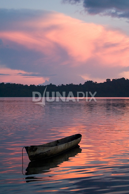 A dugout canoe silhouetted by a spectacular Kia sunset.