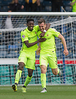 Rakish Bingham (left) of Hartlepool United congratulates Carl Magnay of Hartlepool United on his goal making it 1-1 during the Sky Bet League 2 match between Wycombe Wanderers and Hartlepool United at Adams Park, High Wycombe, England on 5 September 2015. Photo by Andy Rowland.