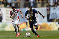 Raymon Gaddis (28) of the Philadelphia Union is marked by Alvaro Rey (23) of Toronto FC. The Philadelphia Union defeated Toronto FC 1-0 during a Major League Soccer (MLS) match at PPL Park in Chester, PA, on October 5, 2013.