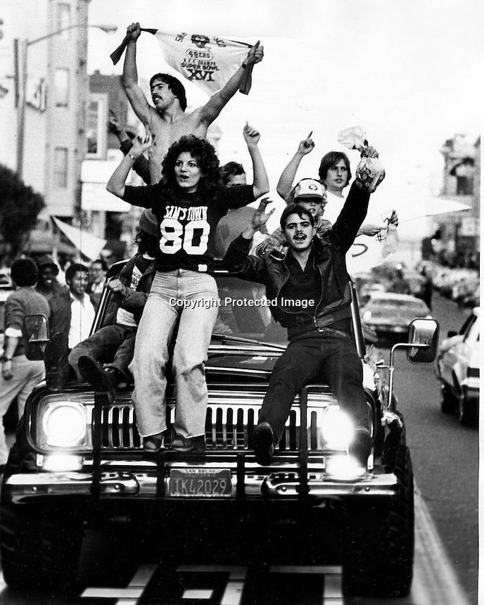Football fans celebrate on Broadway in North Beach, San Francisco after the San Francisco 49ers had just defeated the Cincinnati Bengals in Super Bowl XVI in 1982. (photo by Ron Riesterer)