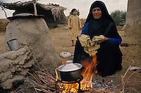 Syrian farmer Women boiling milk