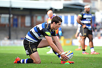 Adam Hastings of Bath Rugby lines the ball up for a kick at the posts. West Country Challenge Cup match, between Gloucester Rugby and Bath Rugby on September 13, 2015 at the Memorial Stadium in Bristol, England. Photo by: Patrick Khachfe / Onside Images