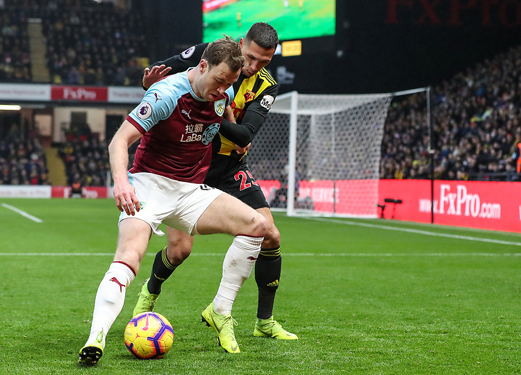 Burnley's Ashley Barnes competing with Watford's Jose Holebas<br /> <br /> Photographer Andrew Kearns/CameraSport<br /> <br /> The Premier League - Watford v Burnley - Saturday 19 January 2019 - Vicarage Road - Watford<br /> <br /> World Copyright &copy; 2019 CameraSport. All rights reserved. 43 Linden Ave. Countesthorpe. Leicester. England. LE8 5PG - Tel: +44 (0) 116 277 4147 - admin@camerasport.com - www.camerasport.com