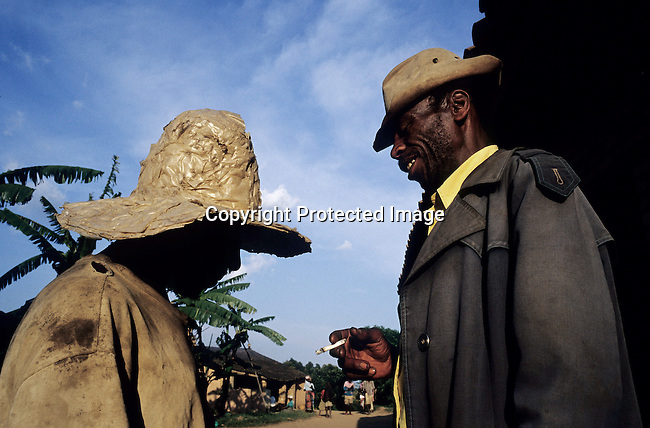 GOTOVO, RWANDA - FEBRUARY 20: (GERMANY AND SOUTH AFRICA OUT) Unidentified old men talk after a Gacaca session February 20, 2003 in Gotovo, Rwanda. Gotovo is one of many small villages where atrocities were committed in 1994, when 800,000 mainly Tutsis and moderate Hutus were killed in about one hundred days in Rwanda. About 100,000 prisoners accused of the genocide are still in prisons nine years later awaiting trials. Rwanda is currently trying to cope with these problems of crime, punishment and reconciliation through village trials called Gacacas. Gacaca, which means on the grass, is a traditional way of solving disputes between local communities and involve juries of residents. 11,000 gacacas are currently trying to resolve crimes from the genocide. (Photo by Per-Anders Pettersson)