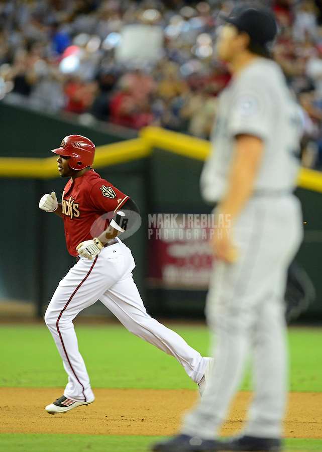 Jun. 20, 2012; Phoenix, AZ, USA; Arizona Diamondbacks outfielder Justin Upton rounds the bases after hitting a three run home run in the fifth inning against the Seattle Mariners at Chase Field.  Mandatory Credit: Mark J. Rebilas-