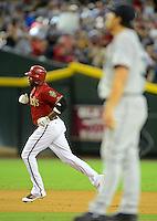 Jun. 20, 2012; Phoenix, AZ, USA; Arizona Diamondbacks outfielder Justin Upton rounds the bases after hitting a three run home run in the fifth inning against the Seattle Mariners at Chase Field.  Mandatory Credit: Mark J. Rebilas-