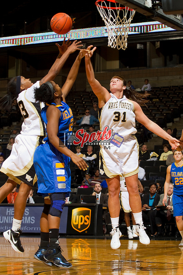 Secily Ray #23 and Lindsy Wright #31 of the Wake Forest Demon Deacons battle for a rebound with Jocelyn Bailey #2 of the Delaware Blue Hens at the LJVM Coliseum on December 11, 2011 in Winston-Salem, North Carolina.  The Blue Hens defeated the Demon Deacons 70-57.    (Brian Westerholt / Sports On Film)
