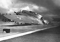 A burned B-17C aircraft rests near Hangar Number Five, Hickam Field, following the attack by Japanese aircraft.  Pearl Harbor, Hawaii.  December 7, 1941.   (Navy)<br /> NARA FILE #:  080-G-32915<br /> WAR &amp; CONFLICT BOOK #:  1139