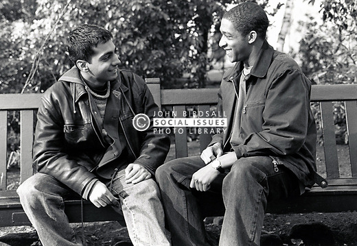 Two young men chatting Nottingham UK 1990s