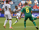 Jomal Williams (20, center) of Trinidad and Tobago shoots on goal as teammate Shahdon Winchester (9, left) of Trinidad and Tobago and Ronayne Marsh-Brown (6) of Guyana watch during their Gold Cup match on June 26, 2019 at Children's Mercy Park in Kansas City, KS.<br /> Tim VIZER/AFP