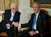 Palestinian President  Mahmoud Abbas, left, and United States President George W. Bush exchange a handshake as they meet at the Waldorf hotel on September 24, 2007 in New York City. Bush will be meeting with several heads of state who are in the city for the United Nation's General Assembly meeting. <br /> Credit: Monika Graff / Pool via CNP