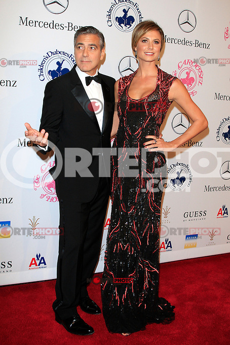 BEVERLY HILLS, CA - OCTOBER 20:  George Clooney, Stacy Keibler at the 26th Carousel Of Hope Ball at The Beverly Hilton Hotel on October 20, 2012 in Beverly Hills, California.   Credit: MediaPunch Inc /NortePhoto .<br />