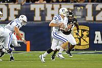 1 October 2011:  FIU linebacker Winston Fraser (34) pursues Duke quarterback Sean Renfree (19) in the first quarter as the Duke University Blue Devils defeated the FIU Golden Panthers, 31-27, at FIU Stadium in Miami, Florida.
