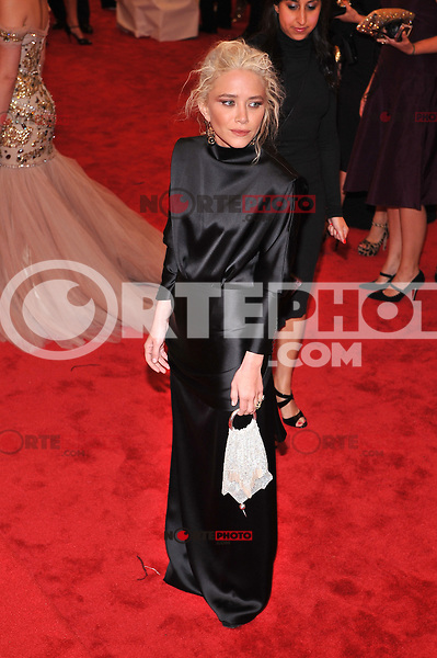 Mary Kate Olsen at the 'Schiaparelli And Prada: Impossible Conversations' Costume Institute Gala at the Metropolitan Museum of Art on May 7, 2012 in New York City. © mpi03/MediaPunch Inc.