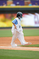 A young fan races down the third base line dressed as a Winston-Salem Dash player during a contest between innings of the game against the Myrtle Beach Pelicans at BB&T Ballpark on April 18, 2015 in Winston-Salem, North Carolina.  The Pelicans defeated the Dash 4-1 in game one of a double-header.  (Brian Westerholt/Four Seam Images)