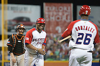 11 March 2009: #43 Hiram Bocachica of Puerto Rico smiles to Angel Gonzalez as he scores during the 2009 World Baseball Classic Pool D game 6 at Hiram Bithorn Stadium in San Juan, Puerto Rico. Puerto Rico wins 5-0 over the Netherlands