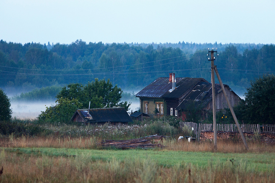 Korovikha, Ivanova Region, Russia, 05/08/2012..Wooden homes in the village of Korovikha,  some 200 miles east of Moscow, shrouded in mist at dawn.