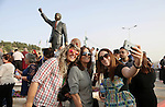 Palestinians take part in ceremony to unveil a sculpture of the first democratically elected South African president and anti apartheid leader Nelson Mandela, in the West Bank city of Ramallah, Tuesday, April 26, 2016. Palestinians honored Mandela unveiling his statue on a square in Ramallah, on South Africa's Freedom Day that is observed annually to commemorate the first post apartheid elections held on April 27, 1994. Photo by Shadi Hatem