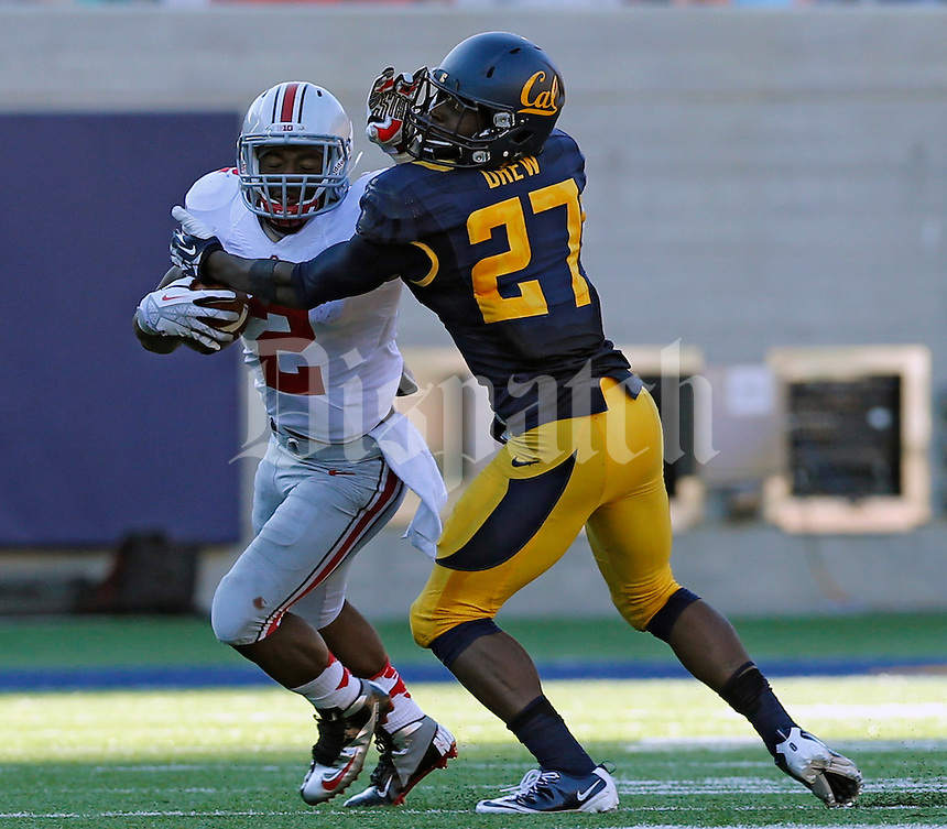 Ohio State Buckeyes running back Jordan Hall (2) tries to run past California Golden Bears defensive back Damariay Drew (27) in the 2nd quarter at Memorial Stadium in Berkeley, California on September 14, 2013.  (Dispatch photo by Kyle Robertson)