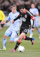 D.C. United midfielder Chris Pontius (13) goes against Sporting Kansas City defender Chance Myres (7) Sporting Kansas City defeated D.C. United  1-0 at RFK Stadium, Saturday March 10, 2012.