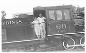 Engineer's-side view of the gangway area of C&amp;S #60 with a couple posing for the camera.<br /> C&amp;S  Idaho Springs, CO