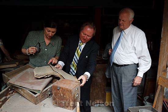 Price - Price - Groundbreaking at the Newhouse Hotel, which is set to be renovated into a new homeless shelter. Thursday May 28, 2009. antiques in the basement. beth wirtz, ben logue, gordon walker with newspapers from 1945
