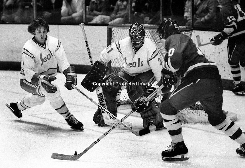 California Golden Seals Len Frig and goalie Gary Simmons &quot;The Cobra&quot; defend North Stars.<br />