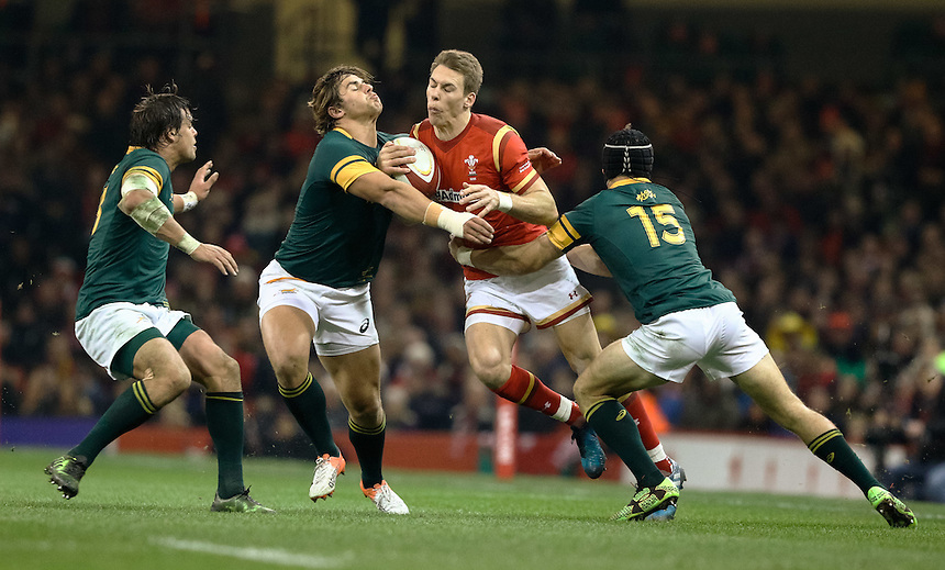 Wales' Liam Williams under pressure from  South Africa's Johan Goosen<br /> <br /> Photographer Simon King/CameraSport<br /> <br /> International Rugby Union Friendly - Wales v South Africa - Saturday 26th November 2016 - Principality Stadium - Cardiff<br /> <br /> World Copyright &copy; 2016 CameraSport. All rights reserved. 43 Linden Ave. Countesthorpe. Leicester. England. LE8 5PG - Tel: +44 (0) 116 277 4147 - admin@camerasport.com - www.camerasport.com