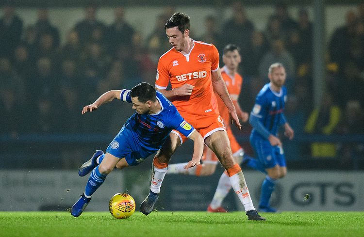 Rochdale's Ian Henderson is fouled by Blackpool's Ben Heneghan<br /> <br /> Photographer Chris Vaughan/CameraSport<br /> <br /> The EFL Sky Bet League One - Rochdale v Blackpool - Wednesday 26th December 2018 - Spotland Stadium - Rochdale<br /> <br /> World Copyright © 2018 CameraSport. All rights reserved. 43 Linden Ave. Countesthorpe. Leicester. England. LE8 5PG - Tel: +44 (0) 116 277 4147 - admin@camerasport.com - www.camerasport.com