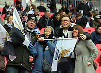 Pictured: Swansea supporters at Wembley Stadium. Sunday 24 February 2013<br /> Re: Capital One Cup football final, Swansea v Bradford at the Wembley Stadium in London.