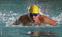 Boston, MA - David Cabrera of East Boston HS competed in the 100 Butterfly event at the 2010 City of Boston swimming championship at Madison Park HS on Thursday, February 4, 2010.
