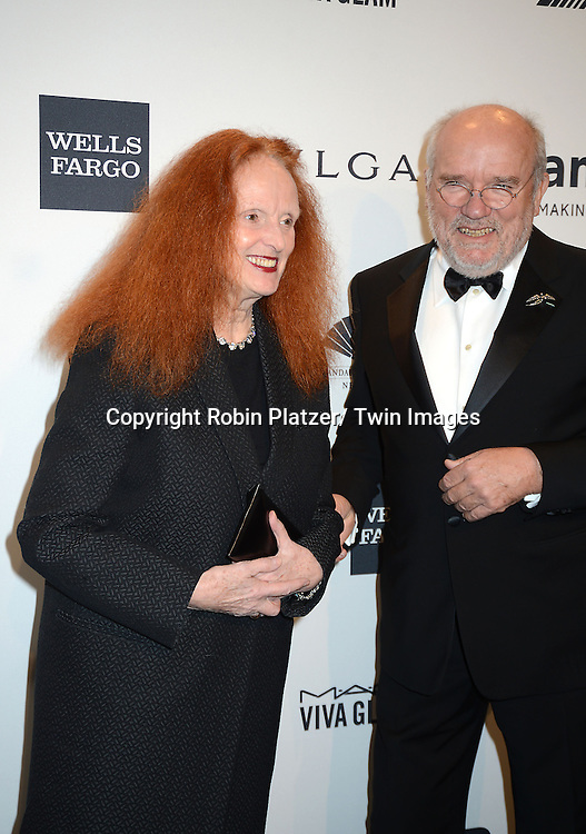 Grace Coddington and Peter Lindburgh attends the amfAR New York Gala on February 5, 2014 at Cipriani Wall Street in New York City.