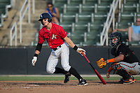 Sam Dexter (23) of the Kannapolis Intimidators follows through on his swing against the Delmarva Shorebirds at Kannapolis Intimidators Stadium on July 2, 2017 in Kannapolis, North Carolina.  The Shorebirds defeated the Intimidators 5-4.  (Brian Westerholt/Four Seam Images)