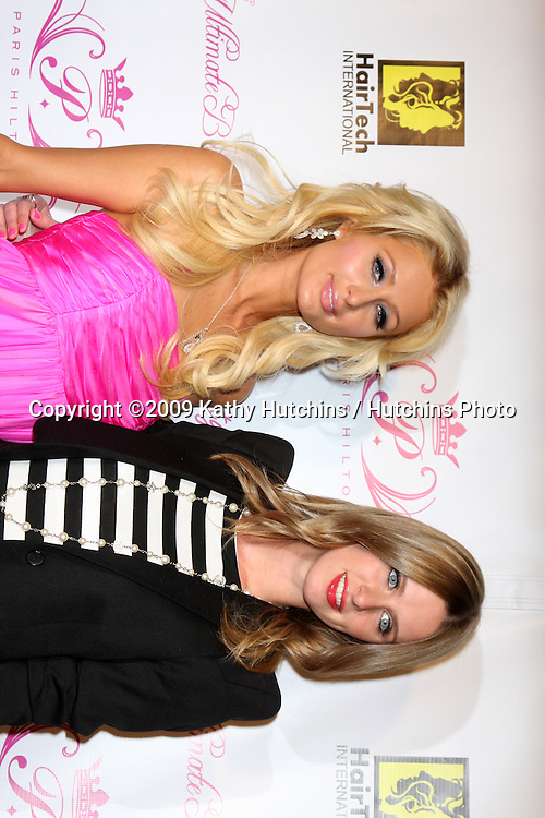 Paris Hilton & Nicky Hilton.arriving at the Paris Hilton Beauty Line Launch Party.Thompson Hotel.Beverly Hills,  CA.November 17, 2009.©2009 Kathy Hutchins / Hutchins Photo.