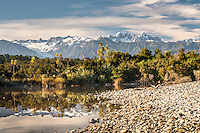 Southern Alps with Mt. Cook (right 3724m) and Mt. Tasman (left 3497m) viewed from Five Mile Lagoon, Westland Tai Poutini National Park, West Coast, UNESCO World Heritage Area, New Zealand, NZ