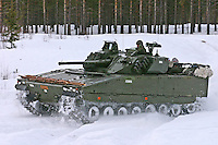 Norwegian Army CV90 armoured vehicle winter training in central Norway.