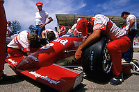 WEST ALLIS, WI - JUNE 2: Truesports Racing crew members work on Bobby Rahal's Budweiser March 85C/Cosworth before practice for the Miller American 200 CART IndyCar race at the Milwaukee Mile in West Allis, Wisconsin, on June 2, 1985.