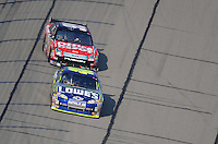 Sept. 28, 2008; Kansas City, KS, USA; Nascar Sprint Cup Series driver Jimmie Johnson leads Carl Edwards to the checkered flag during the Camping World RV 400 at Kansas Speedway. Mandatory Credit: Mark J. Rebilas-